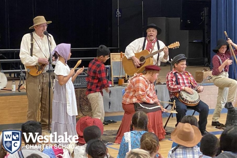 Our 4th graders went back in time today for Pioneer Day! They hand- made ice cream and butter, created art out of tin, made corn-husk dolls, learned about blacksmithing, participated in partner dances and more! #JoyfulLearning